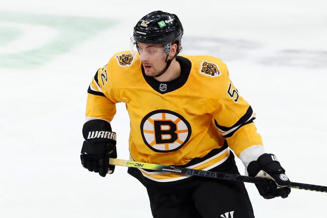 Boston Bruins' Sean Kuraly plays against the New York Rangers during the first period of an NHL hockey game on March 13, 2021, in Boston. Kuraly is currently in COVID-19 protocol along with four other teammates.