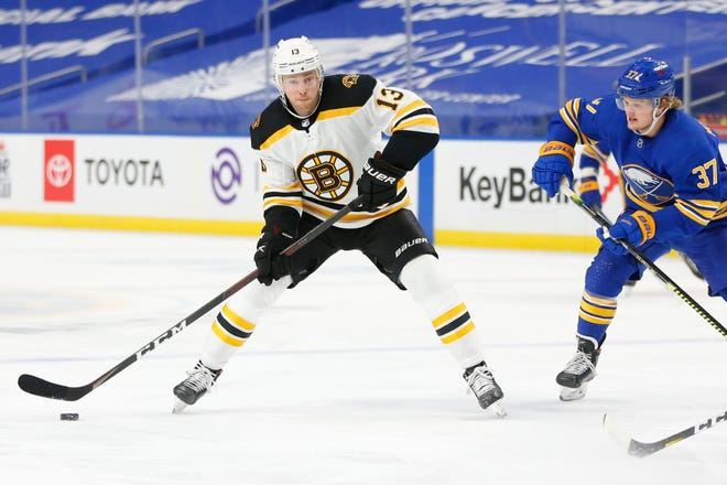 Buffalo Sabres forward Casey Mittelstadt (37) chases Boston Bruins forward Charlie Coyle (13) during the first period of an NHL hockey game, Thursday, March 18, 2021, in Buffalo, N.Y. (AP Photo/Jeffrey T. Barnes)