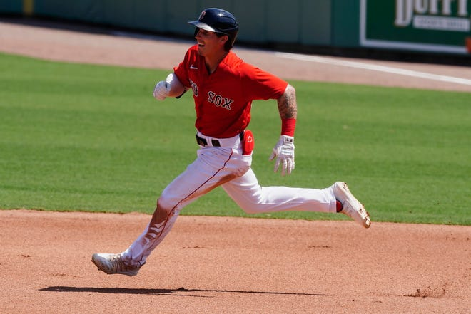 Boston's Jarren Duran runs to second base with a double in the third inning of Friday's spring training game against the Tampa Bay Rays.