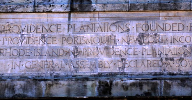 """The word """"Plantations"""" in the marble front high above the Smith Street entrance of the State House."""
