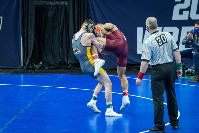 Kent State senior Andrew McNally defeated Cody Howard of Virginia Tech in his first match at the NCAA Championships on Thursday in St. Louis.