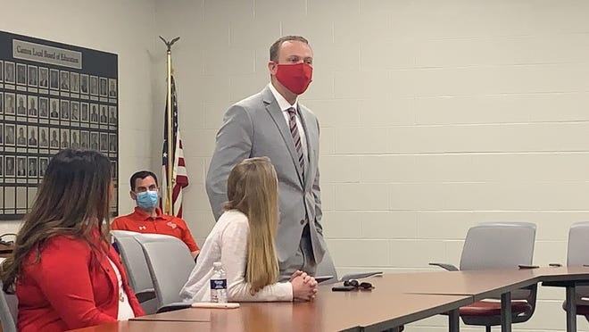 Brett Yeagley speaks to the Canton Local school board Friday after the board voted to hire him as superintendent, starting Aug. 1.