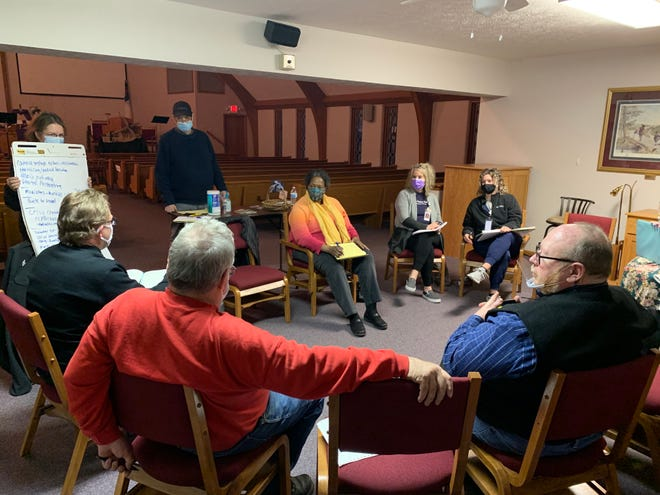 Attendees talk about health care delivery options at a meeting Thursday in North Salina.