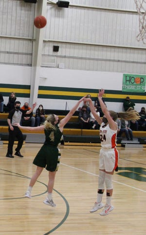 Indian Kadence Hesse shoots in the last Indians/Knights game. Hesse is the leading scorer for the Indians.