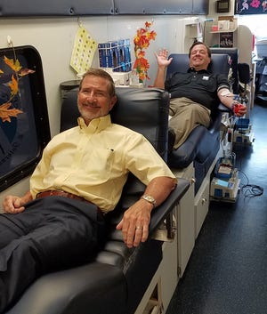Goodwill Manasota president and CEO Bob Rosinsky, front, and chairman of the board Brad West during a 2019 blood drive.