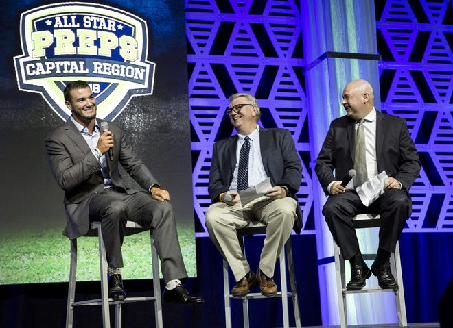 Chicago Bears quarterback Mitch Trubrisky answers questions from former State Journal-Register sports editors Jim Ruppert (middle) and Todd Adams (right) at the 2018 Best of Capital Region Preps awards banquet Friday, June 22, 2018 at the Bank of Springfield Center in Springfield.