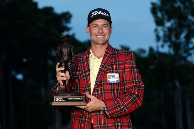 Webb Simpson holds the championship trophy after winning the RBC Heritage golf tournament on June 21, 2020, on Hilton Head Island, S.C.