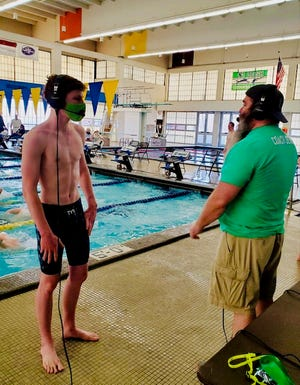 Wethersfield's Colton Mosley is interviewed by meet organizer and Peoria Notre Dame swim coach Derek Amerman during the Midwest Invitational in Peoria.