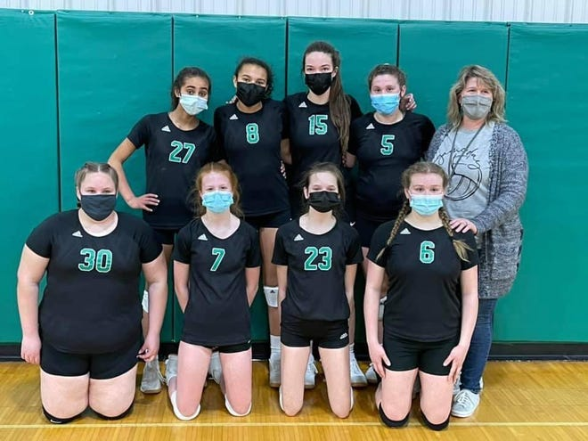 It's hard to see the smiles, but they were there on the faces of the Wethersfield Junior High School volleyball team after winning sectionals Thursday against Brimfield and finishing the season 15-0. The sectional win would normally lead to a place at the state tournament, though that has been cancelled this year.