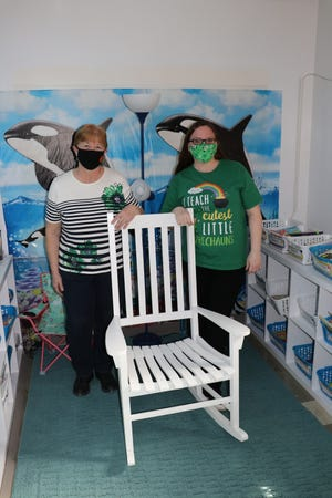 Alice Easterday, left, and kindergarten teacher Sunshine Gonzalez pose Wednesday with a new rocking chair for Gonzalez's classroom.