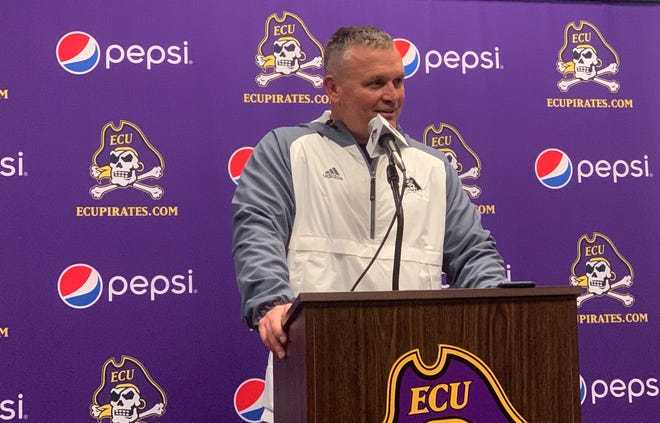 Coach Mike Houston speaks with the media after ECU football's first day of spring practice on Friday evening.