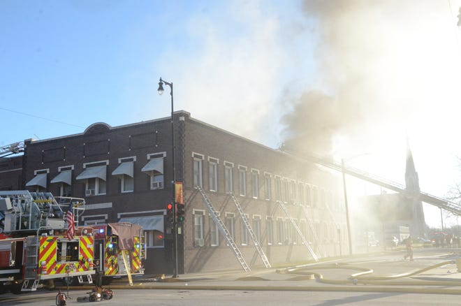 Residents were forced to evacuate after a large fire started Friday morning at the Smith Clinic apartments in downtown Pittsburg.
