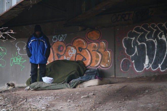 Sleeping arrangements for a homeless man under I-84-East in Hartford.
