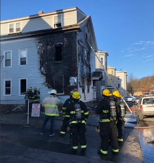 Crews on the scene of a fire at 7 Blossom St. early Friday.