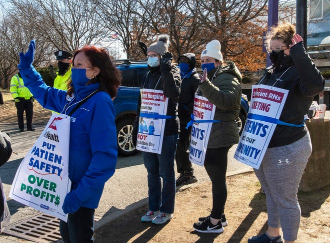 For the 12th consecutive day, nurses and their supporters continue to walk the picket line outside St. Vincent Hospital on Friday in Worcester.