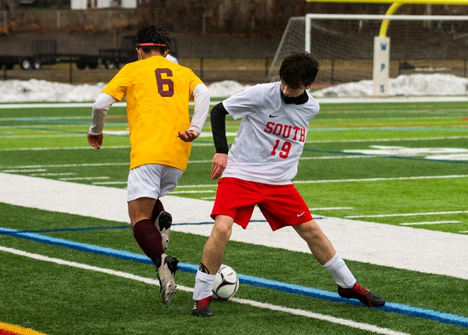 WORCESTER - Doherty's Kevin Ly and South High's Ali Alasadi in action during the game on Thursday, March 18, 2021.