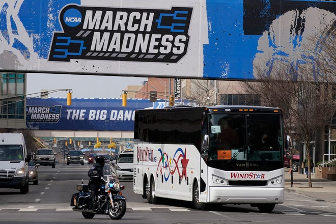 The Florida basketball team is escorted to Hinkle Fieldhouse for an NCAA tournament event Wednesday in Indianapolis. The Gators play Virginia Tech in the first round Friday.