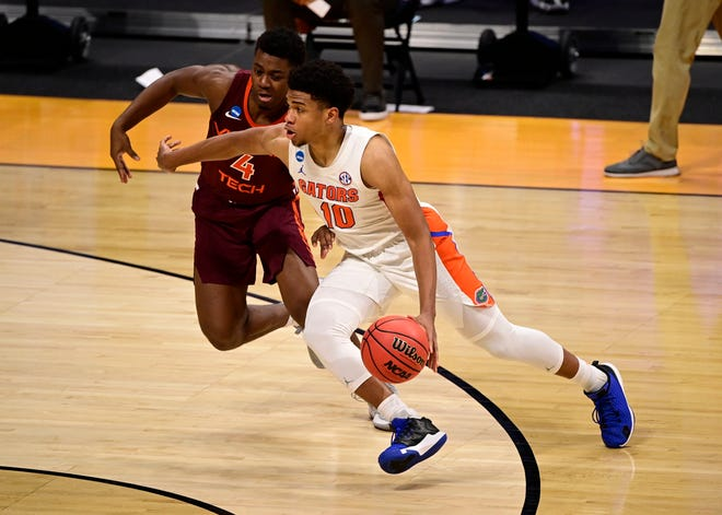 Florida Gators guard Noah Locke (10) dribbles against Virginia Tech Hokies guard Nahiem Alleyne (4) during the first round of the NCAA Tournament on Friday, March 19, 2021, at Hinkle Fieldhouse in Indianapolis.