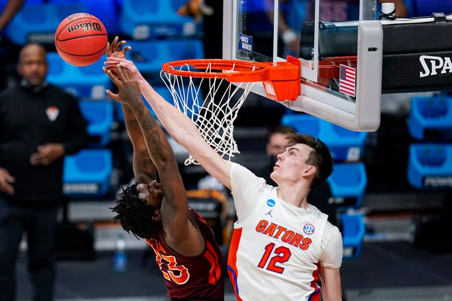 Florida forward Colin Castleton blocks the shot of Virginia Tech guard Tyrece Radford in the second half Friday of a first-round game in the NCAA men's college basketball tournament at Hinkle Fieldhouse in Indianapolis.