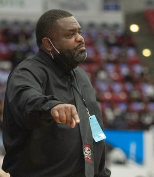 Santa Fe High School basketball coach Elliot Harris instructs his players against Pine Crest during the second half of the FHSAA Boys 4A Championship game at The RP Funding Center in Lakeland on March 6.