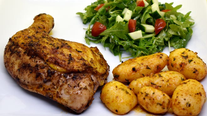 Clockwise from left, Lemon and Thyme Roasted Chicken Leg Quarters, Arugula Salad with Lemon Parmesan Dressing and Roasted Potatoes.