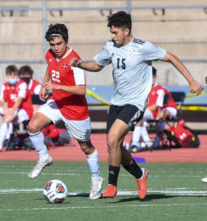 Pueblo South's Jovan Sanchez, right, looks to move upfield with Pueblo Centennial's Sam Alcaraz defending Thursday, March 18, 2021, at Dutch Clark Stadium.
