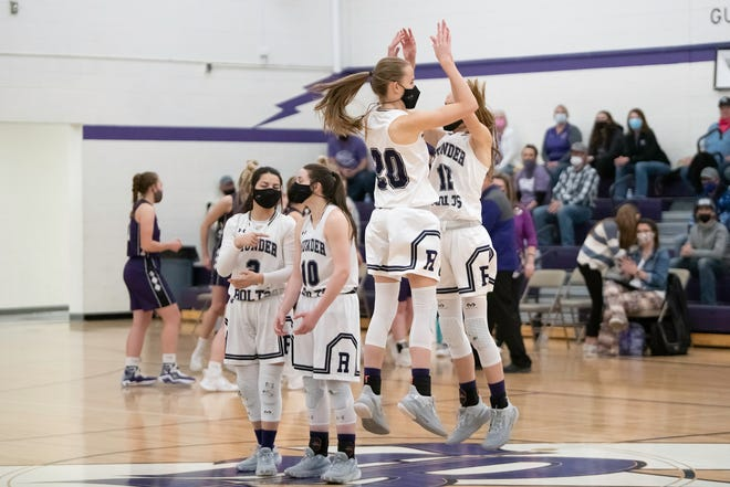 Rye High School's Sophie and Sydney Adamson do a jumping high five during introductions at the Class 2A Final Four matchup with Wray on Thursday March 18, 2021.