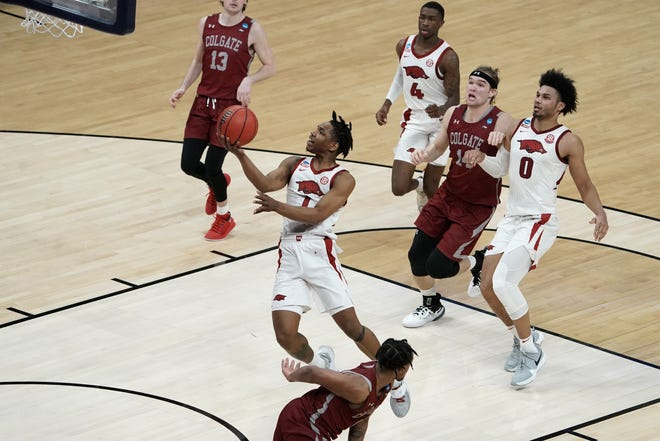 Mar 19, 2021; Indianapolis, Indiana, USA; Arkansas Razorbacks guard JD Notae (1) goes to the basket as Colgate Raiders forward Keegan Records (14) looks on during the second half in the first round of the 2021 NCAA Tournament at Bankers Life Fieldhouse. Mandatory Credit: Kirby Lee-USA TODAY Sports