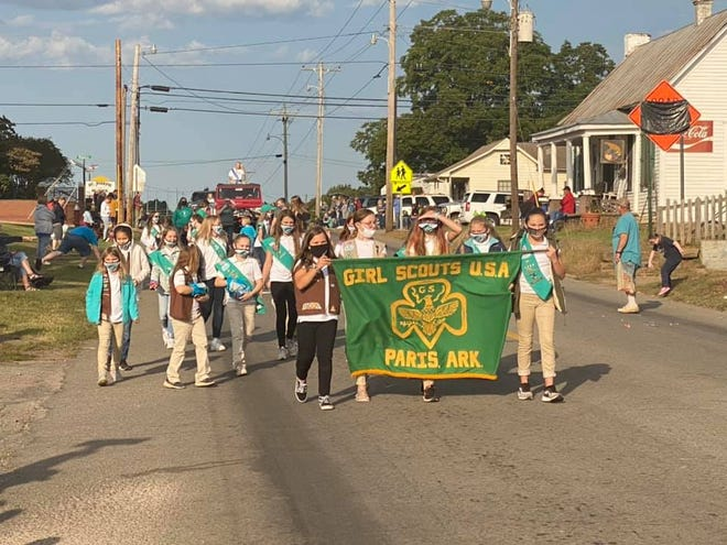 Paris Girl Scouts march in parade.