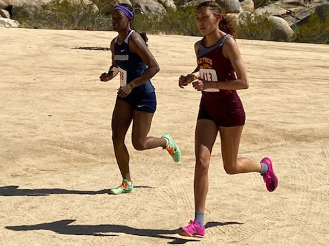 Silverado's Zoe Smith, left, and Barstow's Angelina Vasquez compete in the third Desert Sky League cluster meet of the season in Apple Valley on Thursday.