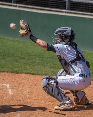 Waxahachie sophomore catcher Jaxson Crow works behind the dish during a recent game at Richards Park. The Indians made their District 11-6A debut a successful one as they blanked Cedar Hill, 9-0, on Tuesday.