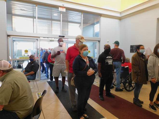 A large crowd streams through the Waxahachie Senior Activity Center on Wednesday to receive their first dose of the Pfizer COVID-19 vaccine. Almost 2,000 shots were given, Ellis County officials said.