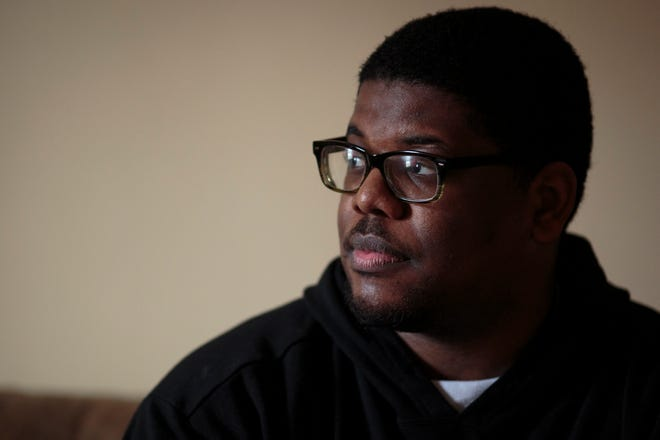 Dumariyea Ballew, 25, sits on the couch in his apartment in his College Hill neighborhood. Ballew thought he was set after accepting a job as an admissions counselor for Chatfield College in February 2020, but after the coronavirus pandemic took hold, he was soon laid off.