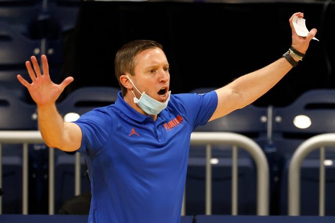 Florida men's basketball coach Mike White signed a two-year contract extension last month.