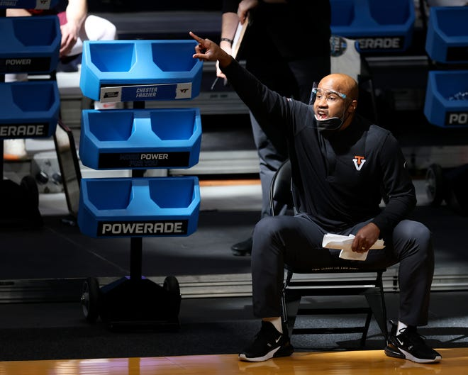Virginia Tech Hokies associate head coach Chester Frazier instructs the team in the first half of a first-round game of the 2021 NCAA Tournament against the Florida Gators on Friday, March 19, 2021, at Hinkle Fieldhouse in Indianapolis, Ind.
