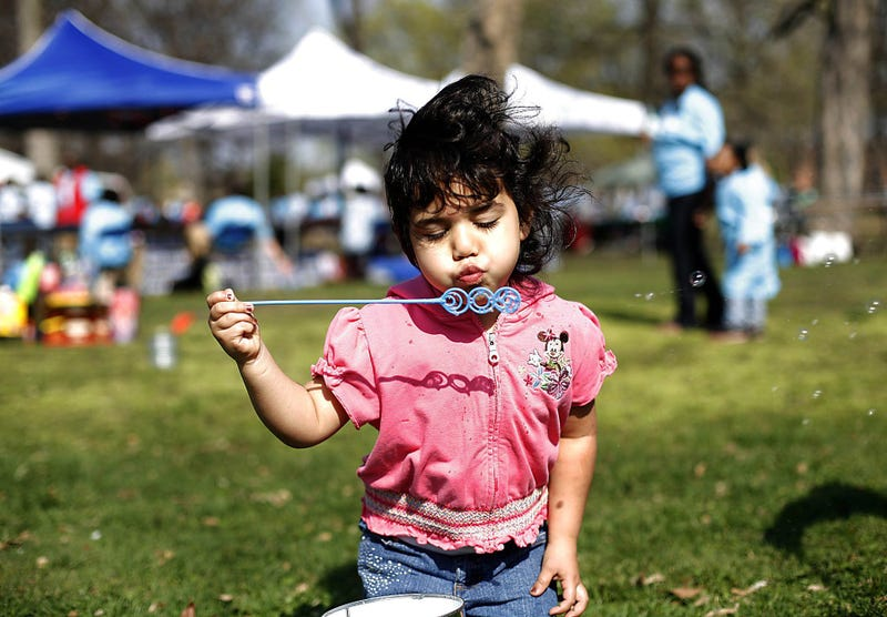 Yari Garza, 4, of Detroit, blows bubbles during the Dia de los Ninos and Dia de los Libros (The Day of Children and the day of books) event at Clark Park in Detroit, on April 25, 2009. The event features, books, reading activities, storytelling, arts and crafts and fun foods.
