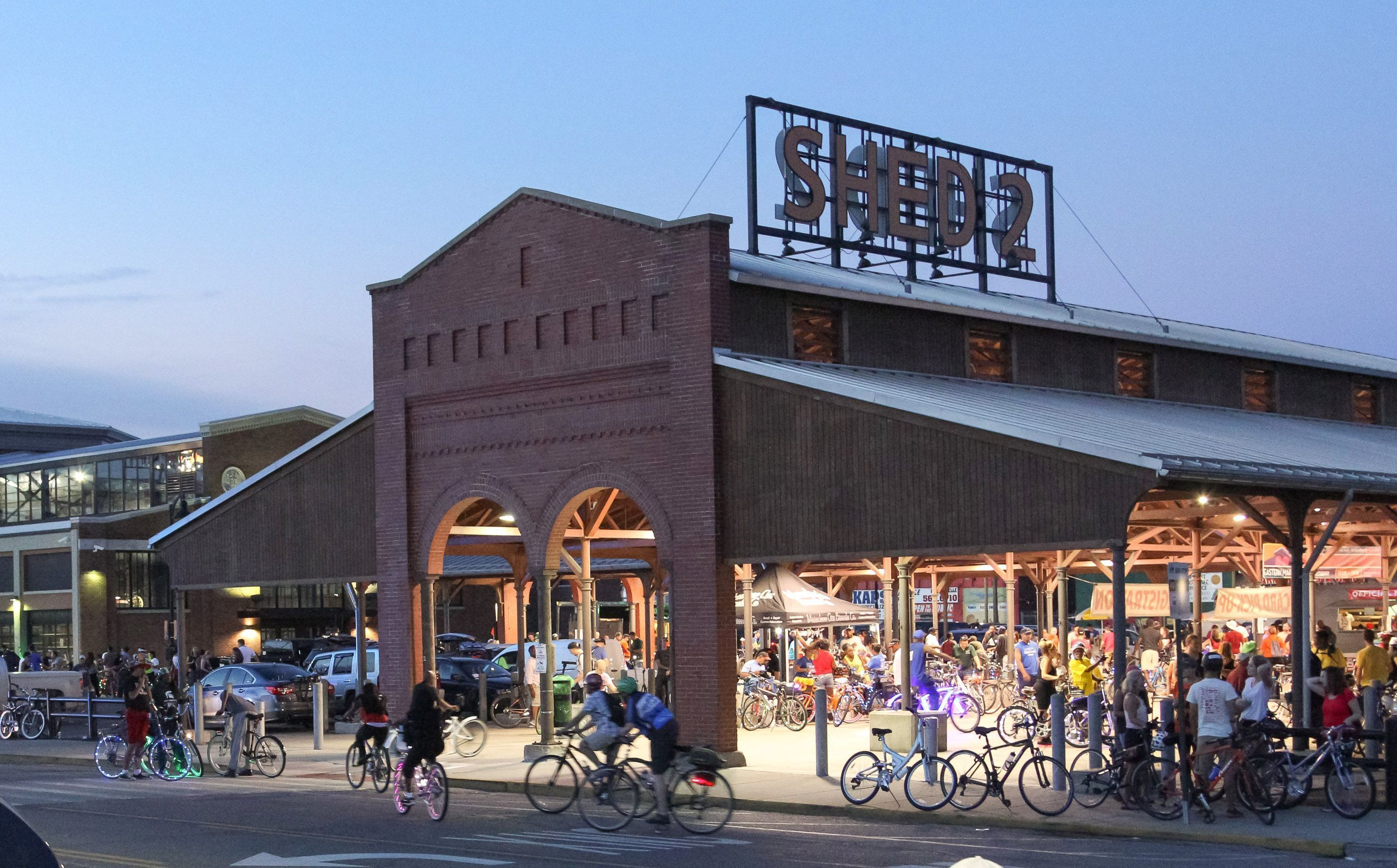 Thousands of bicycle enthusiasts took part in a murals themed Slow Roll centered around Shed 2 in Eastern Market in September 2016.