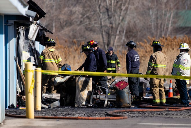 Green Bay Metro Fire Department firefighters work the scene of a fire at Lok-Safe Storage, Friday, March 19, 2021, Green Bay, Wis. Samantha Madar/USA TODAY NETWORK-Wisconsin
