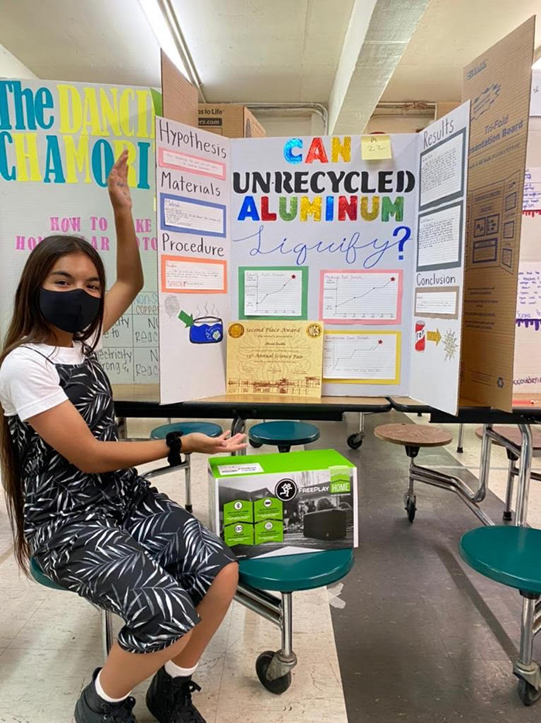 Alexia Saville placed second in the March 19, 2021, Mount Carmel School science fair competition, winning a speaker, for her project: Can Unrecycled Aluminum Liquify?