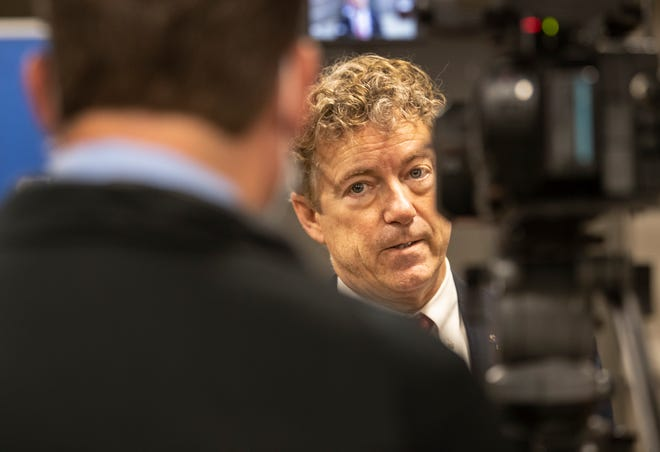 Sen. Rand Paul, R-Ky., answers questions from he media following a press conference in Louisville on March 19, 2021.