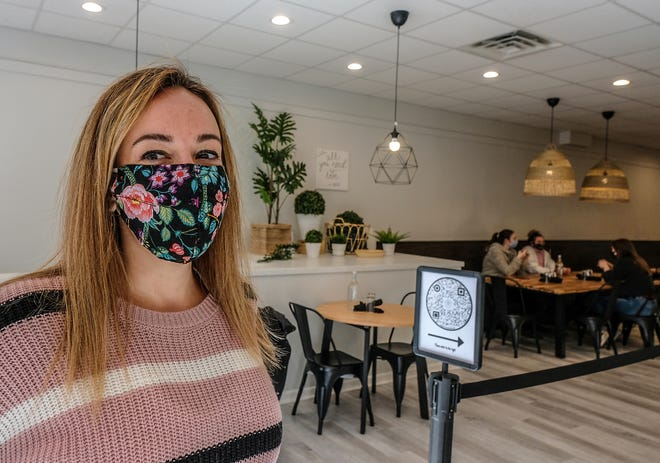 Gina Mudrey, co-owner of For Crêpe Sake in East Lansing in the eatery's new space, the former Mackeral Sky Gallery of Contemporary Art on M.A.C. Avenue.