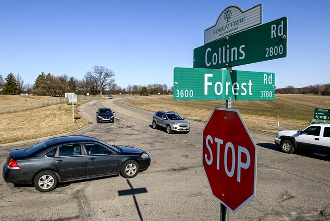 Traffic moves through the Collins and Forest roads intersection on Friday, March 19, 2021, in Lansing. The city is proposing a roundabout for the intersection which it hopes will prevent crashes.