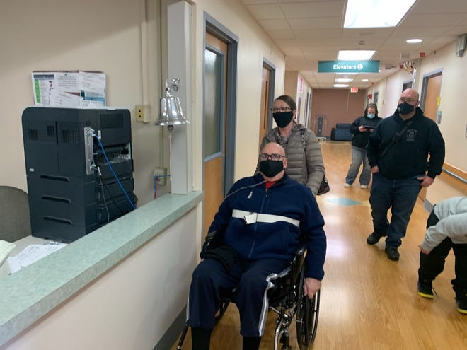 Jim and Deb Newland leaving St. Rita's Medical Center in Lima Friday, March 19, 2021. Jim Newland contracted COVID-19 in December, and was hospitalized at Marion General Hospital for two months.