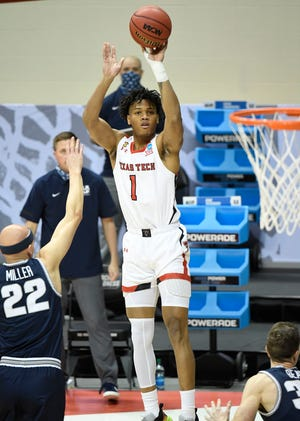 Texas Tech Terrence Shannon Jr. (1) shoots over Utah State guard Brock Miller (22) during a first-round NCAA Tournament game Friday at Simon Skjodt Assembly Hall in Bloomington, Indiana.