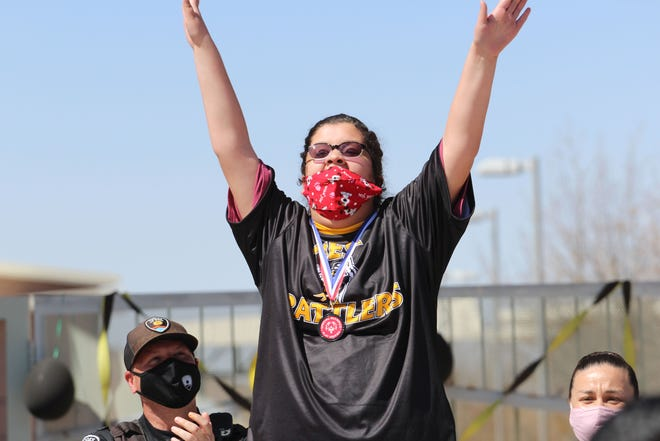 Davina Silva shows her excitement after receiving a medal for competing in the Special Olympics at Mesa Middle School on Friday, March 19, 2021.