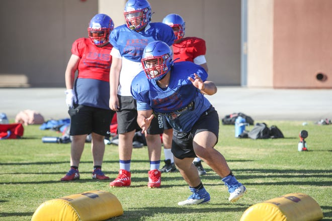 The Indio High football team practices for the upcoming season, March 18, 2021.