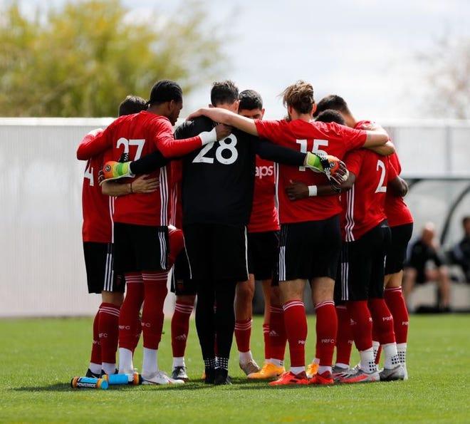 Phoenix Risingn FC players gather before a preseason game.