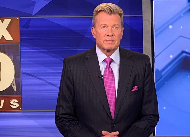 Fox 10 news anchor John Hook on the set. Hook missed three weeks of work after contracting COVID-19.