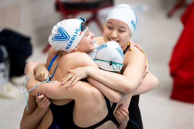 Villa Maria's Megan Maholic, Olivia Mottillo, Jasmine Chen and Haley Palmer celebrate after winning gold in the 200-yard medley relay with a time of 1:46.18 at the PIAA Class 2A swimming championships in Mechanicsburg on Friday