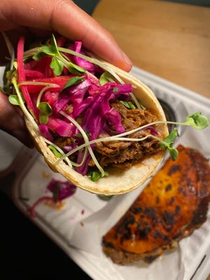 The spicy lamb taco from Mexcal topped with pickled red onions and cabbage.